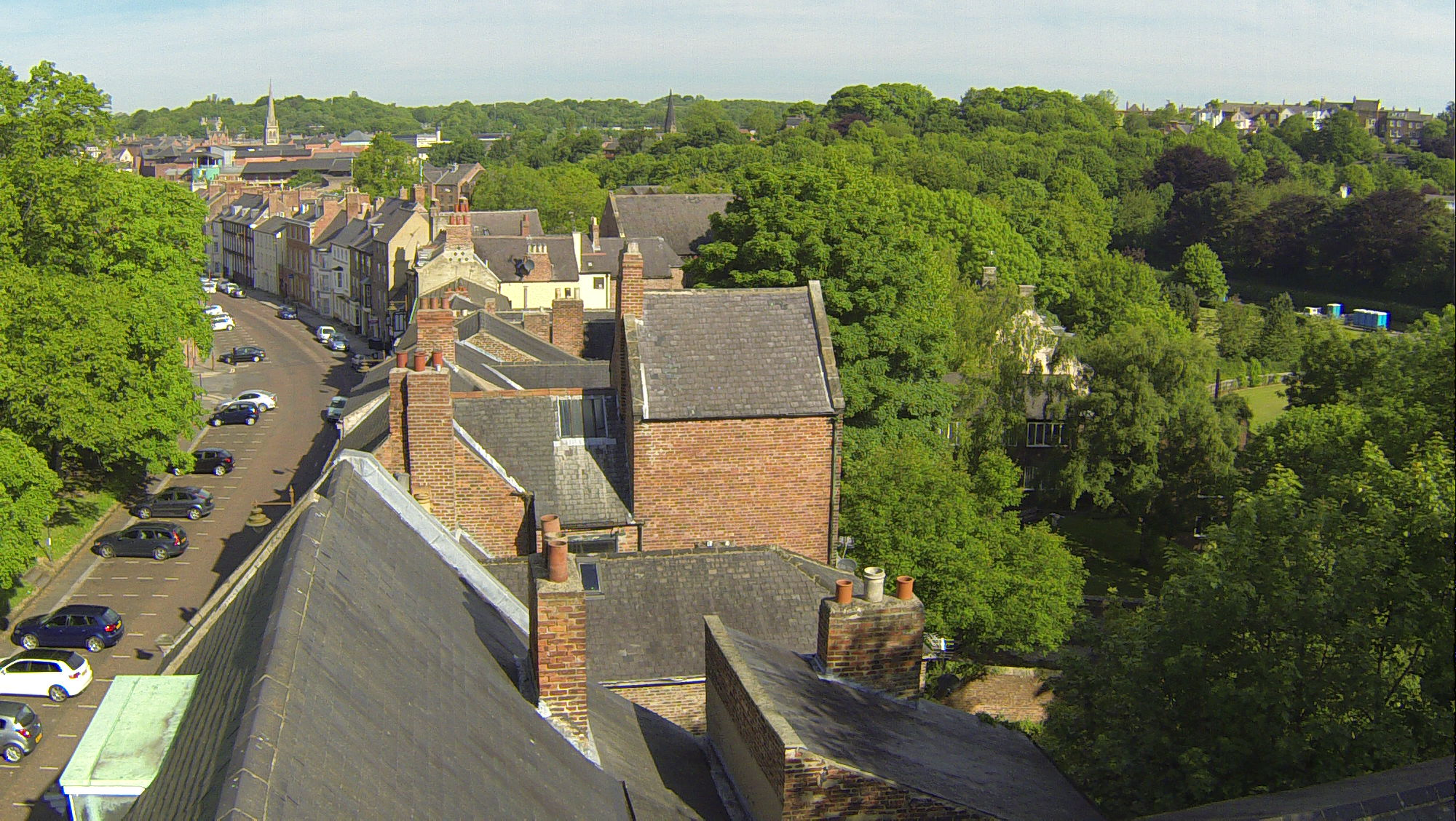 Aerial view of rooftops and chimneys - Survey Drones