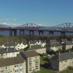 Aerial view of bridge and rooftops - Survey Drones