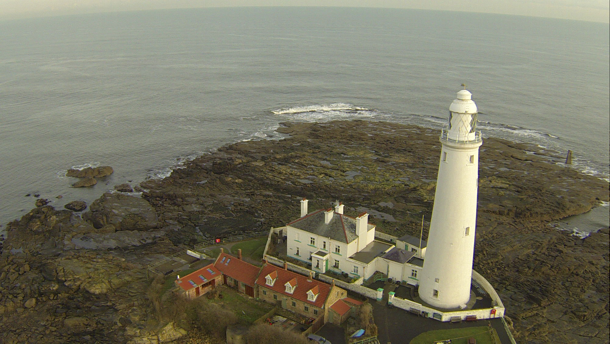Aerial View of St Marys Lighthouse and Sea - Survey Drones